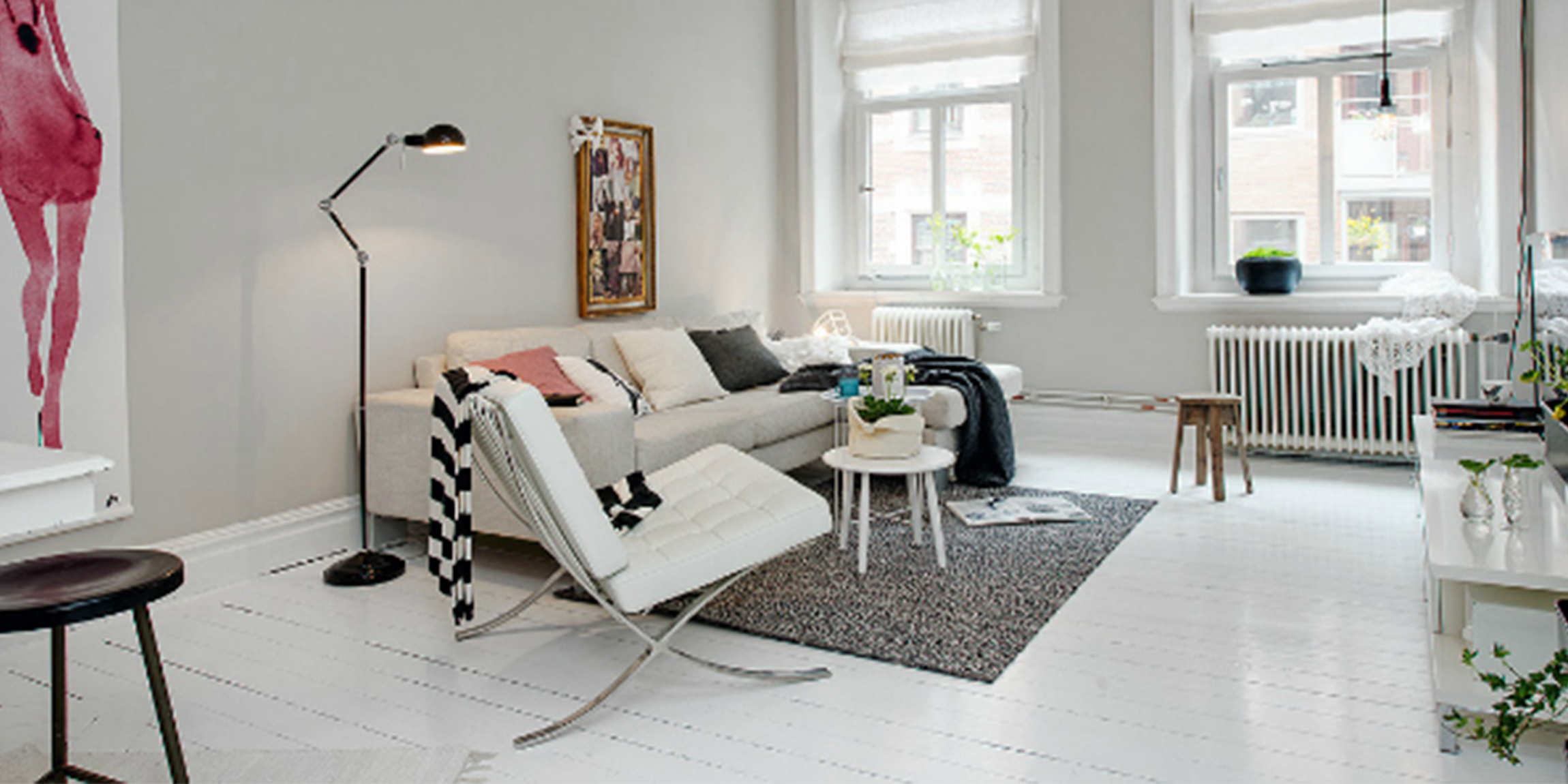 Living Room Featuring a Barcelona Chair