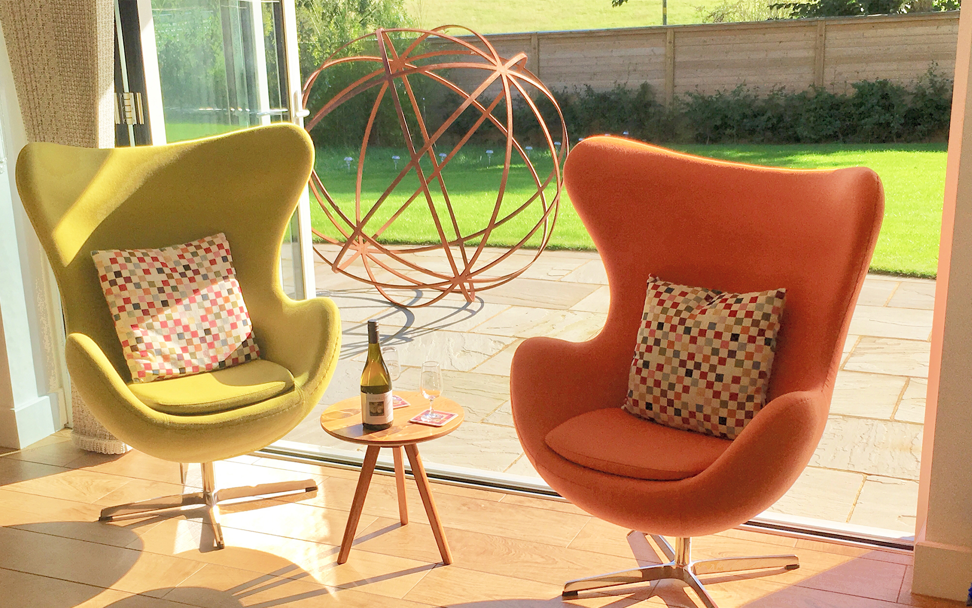 Olive Green & Orange Egg Chairs in a Living Space