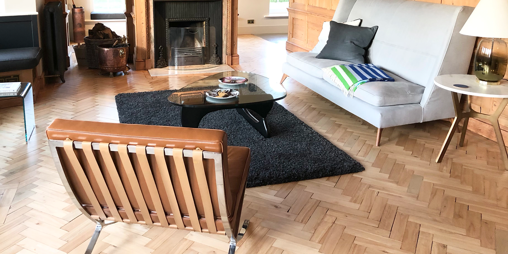 Living Room Featuring our Barcelona Chair & Noguchi Coffee Table